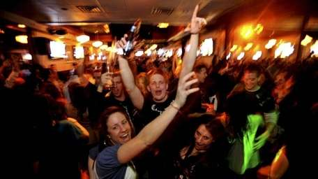 People partying at the now-defunct McFadden's in Rockville