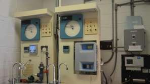 A collection of monitors and gauges track chlorine,