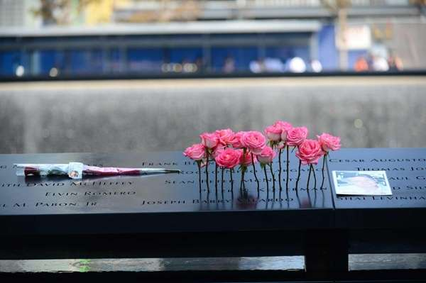 Flowers stand in a name at the 9/11