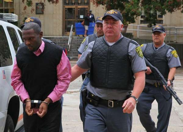 Darrell Fuller, accused of the shooting death of Nassau Police officer Arthur Lopez, arrives at the Nassau County Courthouse in Mineola. (Sept 16, 2013)