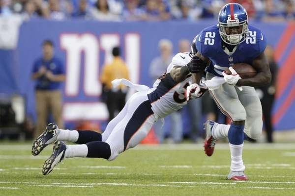 Denver Broncos' Duke Ihenacho tackles New York Giants'