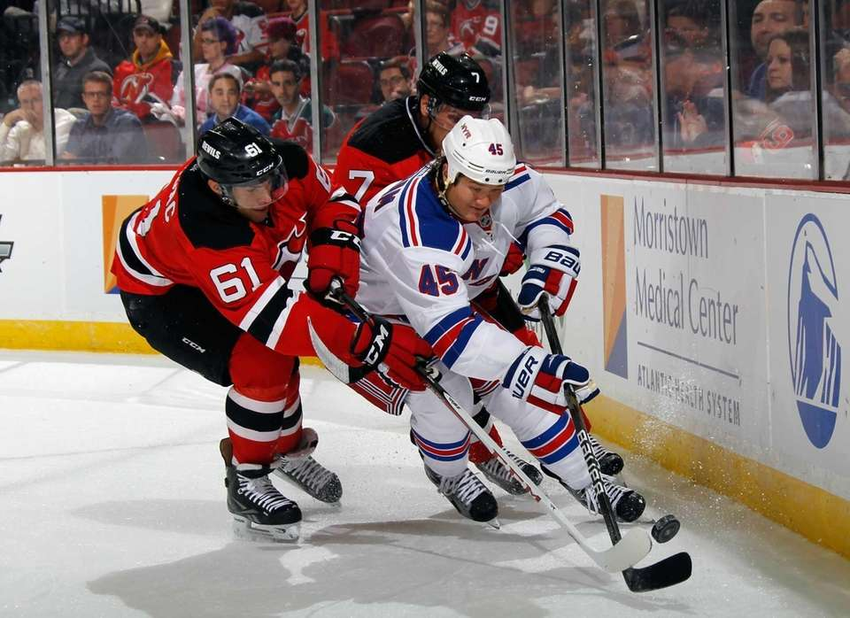Arron Asham of the Rangers (no. 45) moves