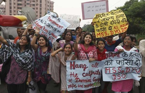 Indians hold placards as they shout slogans seeking