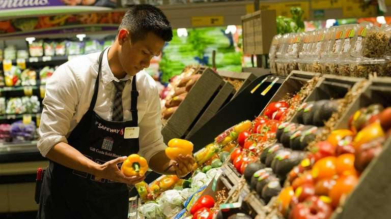 Fresh produce is stocked at a Safeway store
