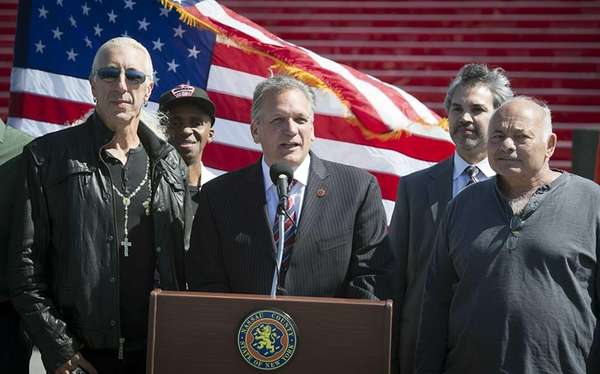Nassau County Executive Edward Mangano stands with rock