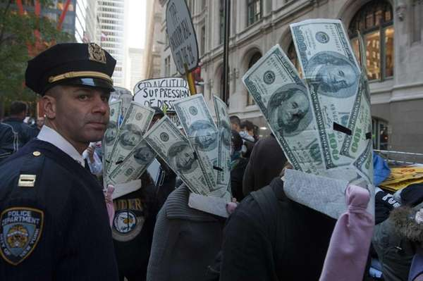 Occupy Wall Street demonstrators march around Zuccotti Park