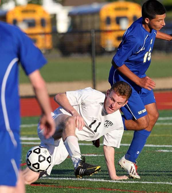 Hicksville's Daniel Sloan tries to control ball while