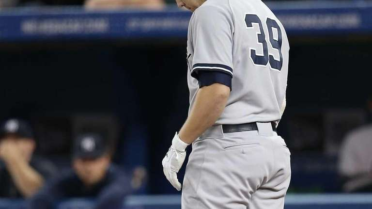 Mark Reynolds of the Yankees reacts after striking