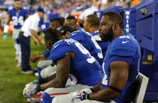 Defensive end Justin Tuck of the Giants sits