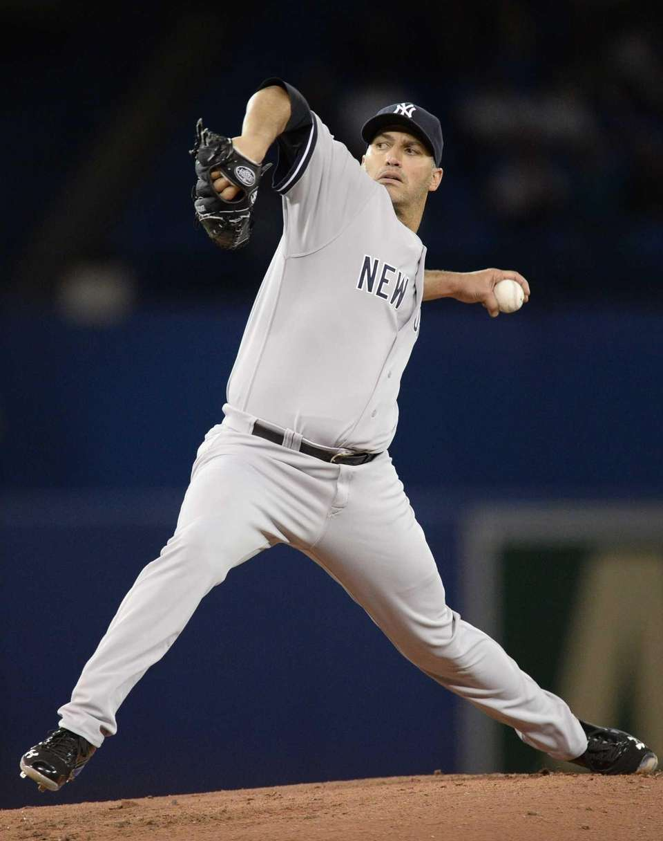 Yankees starter Andy Pettitte pitches to the Toronto
