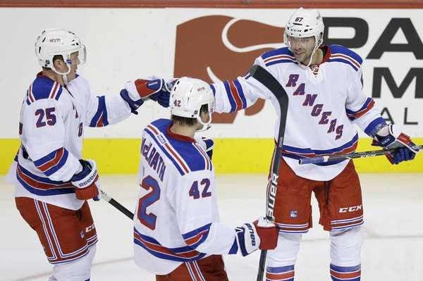 Rangers' Benoit Pouliot, right, celebrates with Dylan McIlrath,