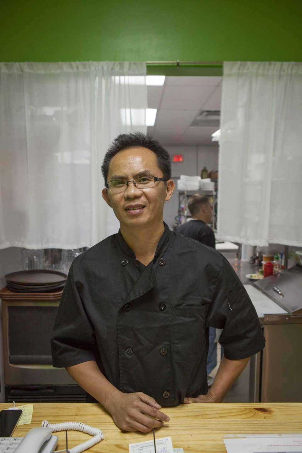 Owner and chef Joe Bui behind the counter