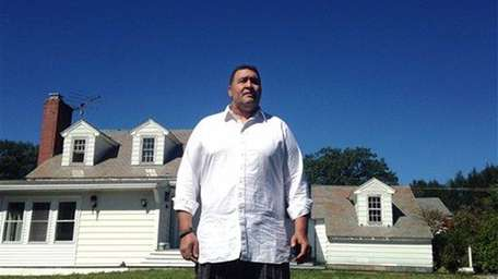 Former NFL offensive lineman Brian Holloway stands in