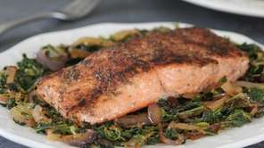 Spice-rubbed salmon on caramelized onion and spinach.