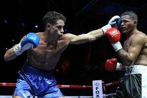 Chris Algieri (L) lands a left against Wilfredo