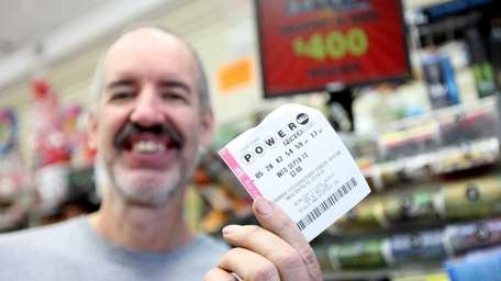 John Siehien of Plainview shows off the Powerball