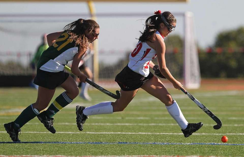 Sachem East's Cara Trombetta stick handles as Ward