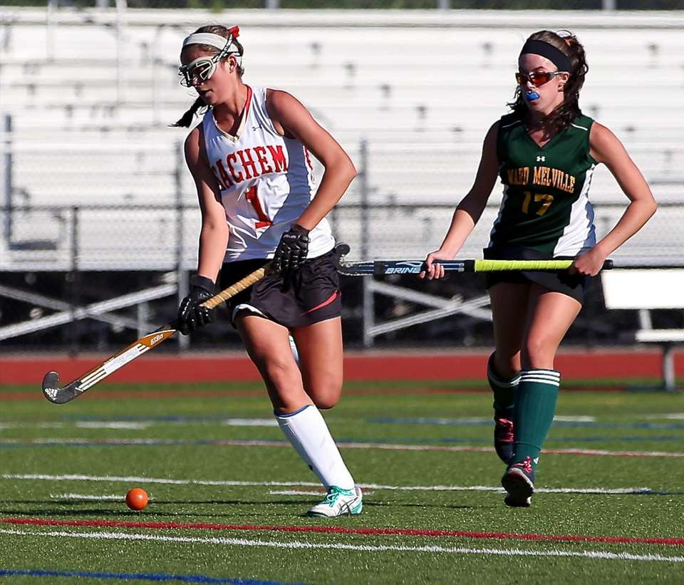 Sachem East's Katie Trombetta moves the ball against