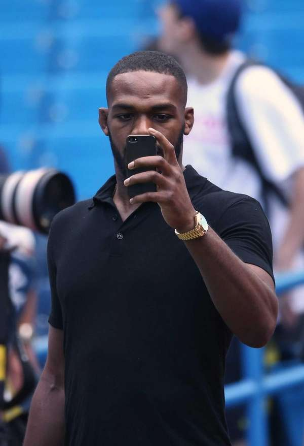 UFC fighter Jon Jones checks his photo before