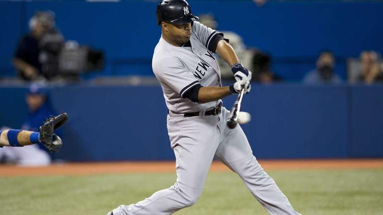 Yankees' Vernon Wells hits a single against the