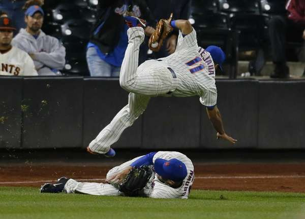 Ruben Tejada of the Mets is tripped up