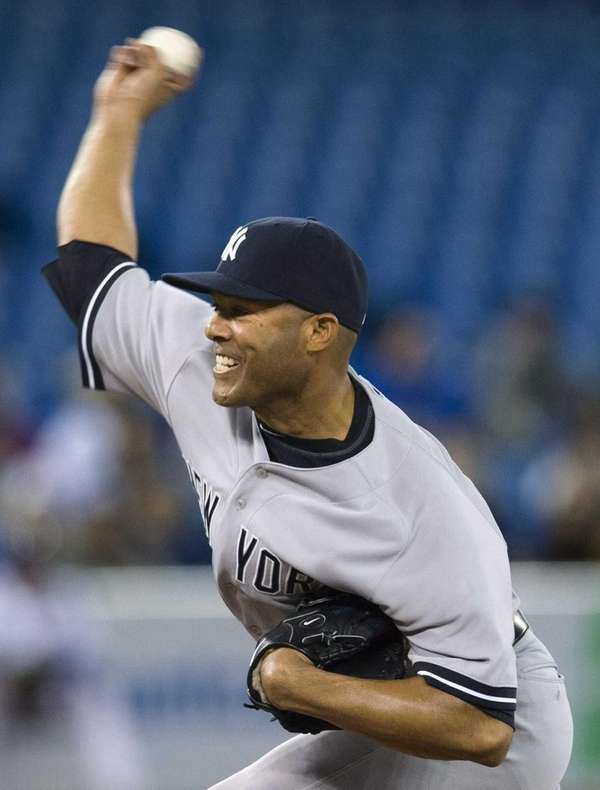 Yankees closer Mariano Rivera pitches to the Toronto