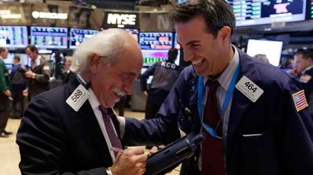 Traders Peter Tuchman, left, and Gregory Rowe share