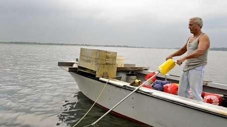 Bob DeFeo, 52, of Oyster Bay, works to