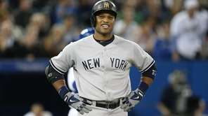 Robinson Cano of the Yankees reacts after his