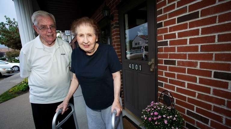 Jack Armitage and his wife, Joan, stand outside