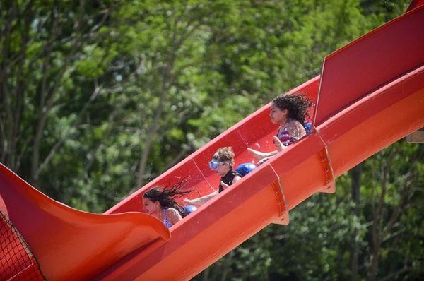 Children plummet in a raft while riding Bootlegger