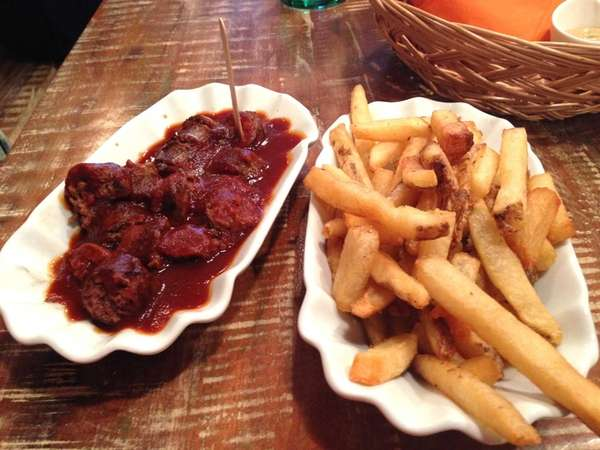 American Kobe beef currywurst with fries at The