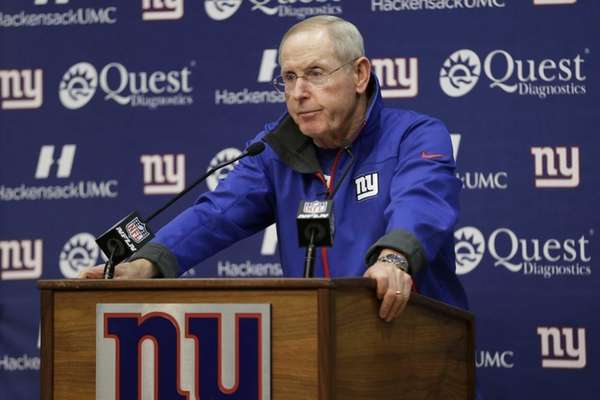 Tom Coughlin talks to the media during an