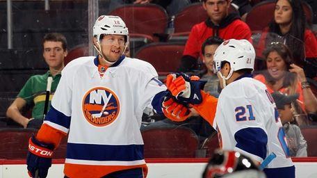 Josh Bailey, left, of the Islanders celebrates his