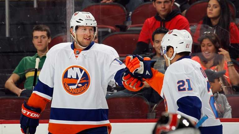 Josh Bailey, left, of the Islanders celebrates his