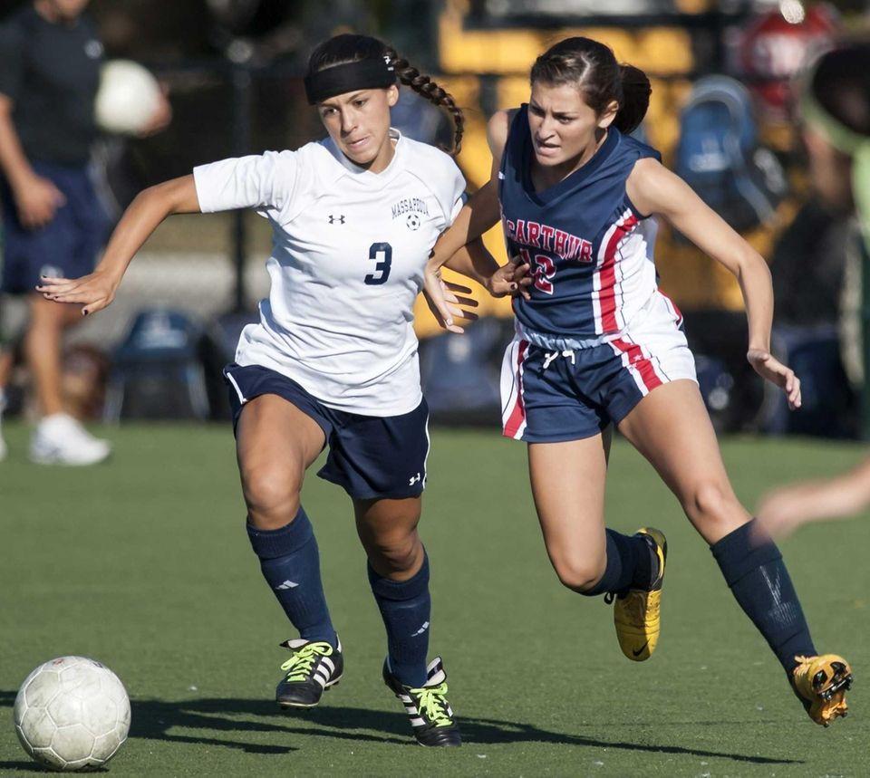 Massapequa's Olivia Stegner, left, goes after the ball