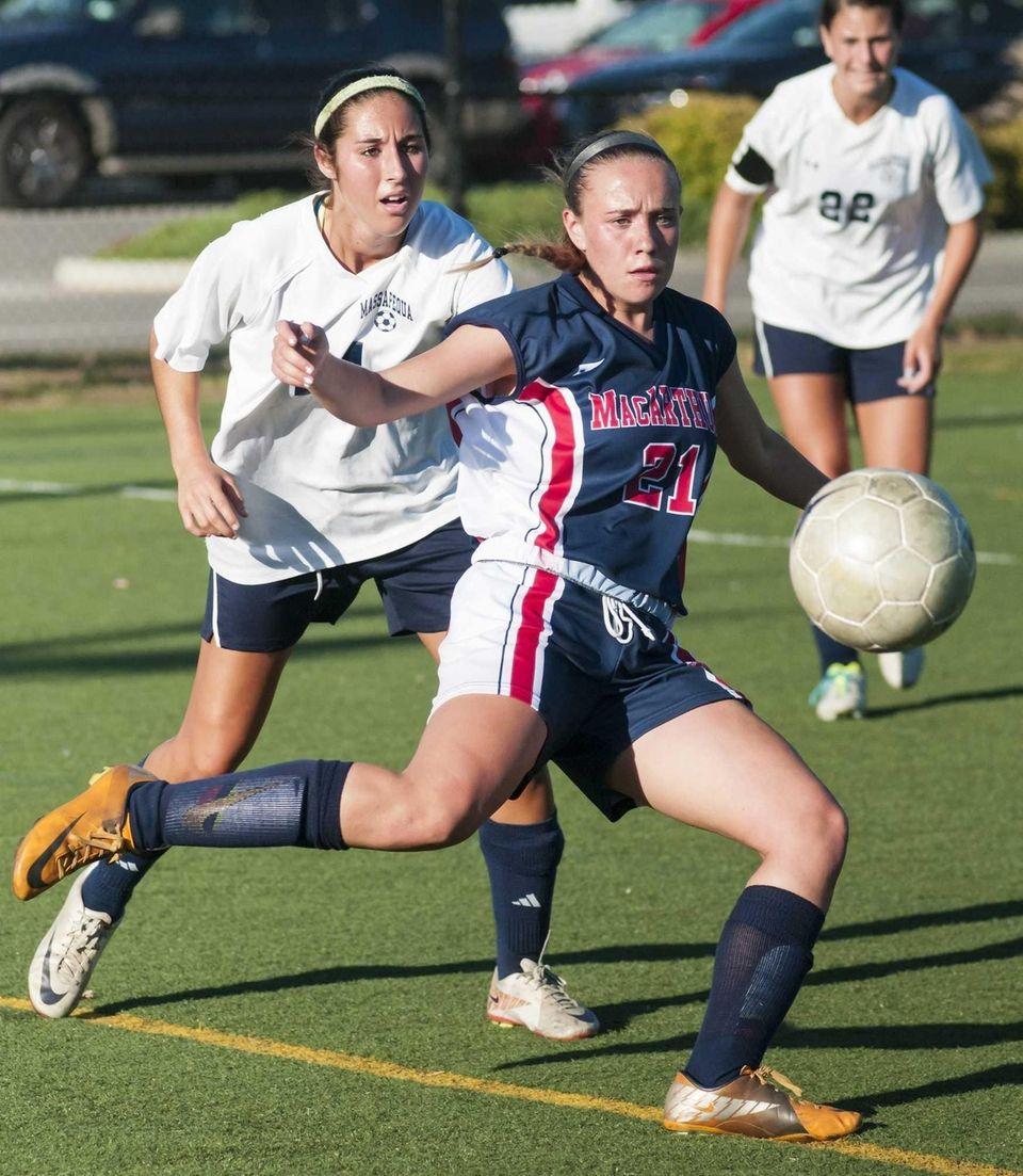Massapequa's Taylor Kugler, left, goes after the ball