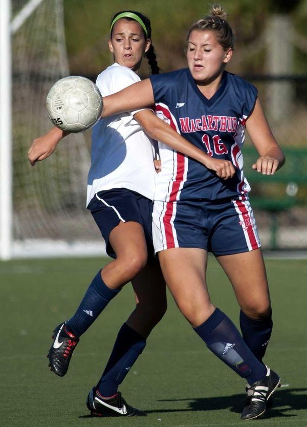 Massapequa's Nicolette LaRosa, left, fights for the ball