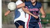 Massapequa's Nicolette LaRosa, left, fights for the ball