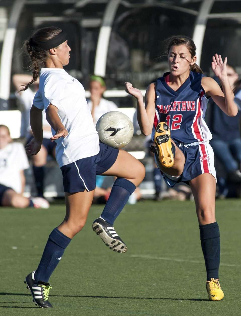 MacArthur's Nicole Greenwald, left, goes after the ball
