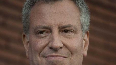 Democratic mayoral candidate Bill de Blasio takes part