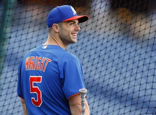 David Wright of the Mets waits to step