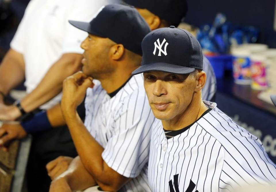Joe Girardi of the Yankees looks on before