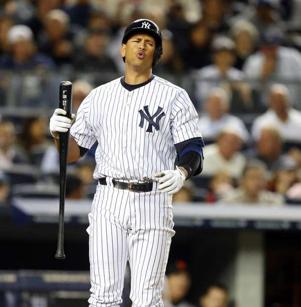 Alex Rodriguez of the Yankees reacts after striking