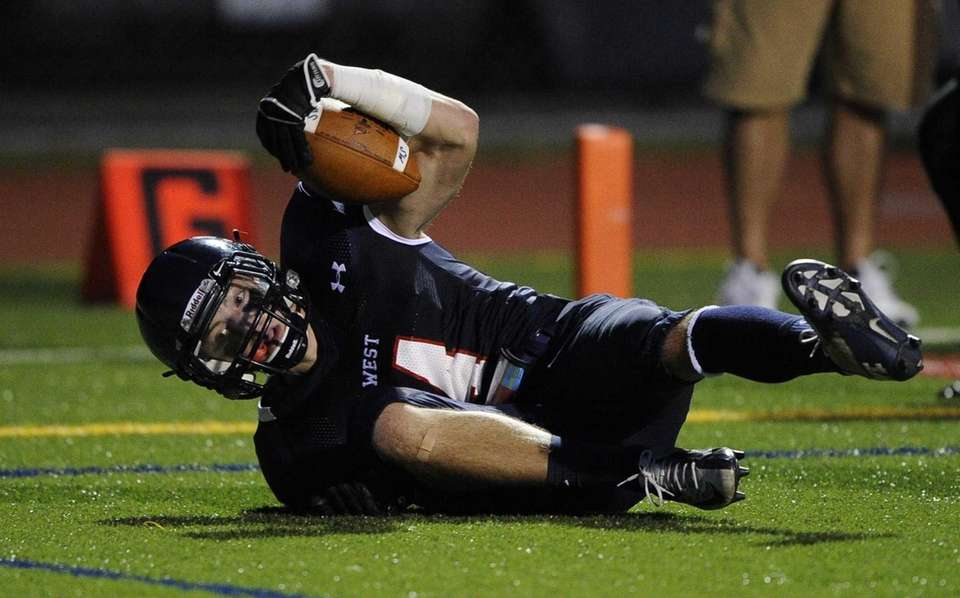 Smithtown West's Kyle A. Mathie scores a touchdown