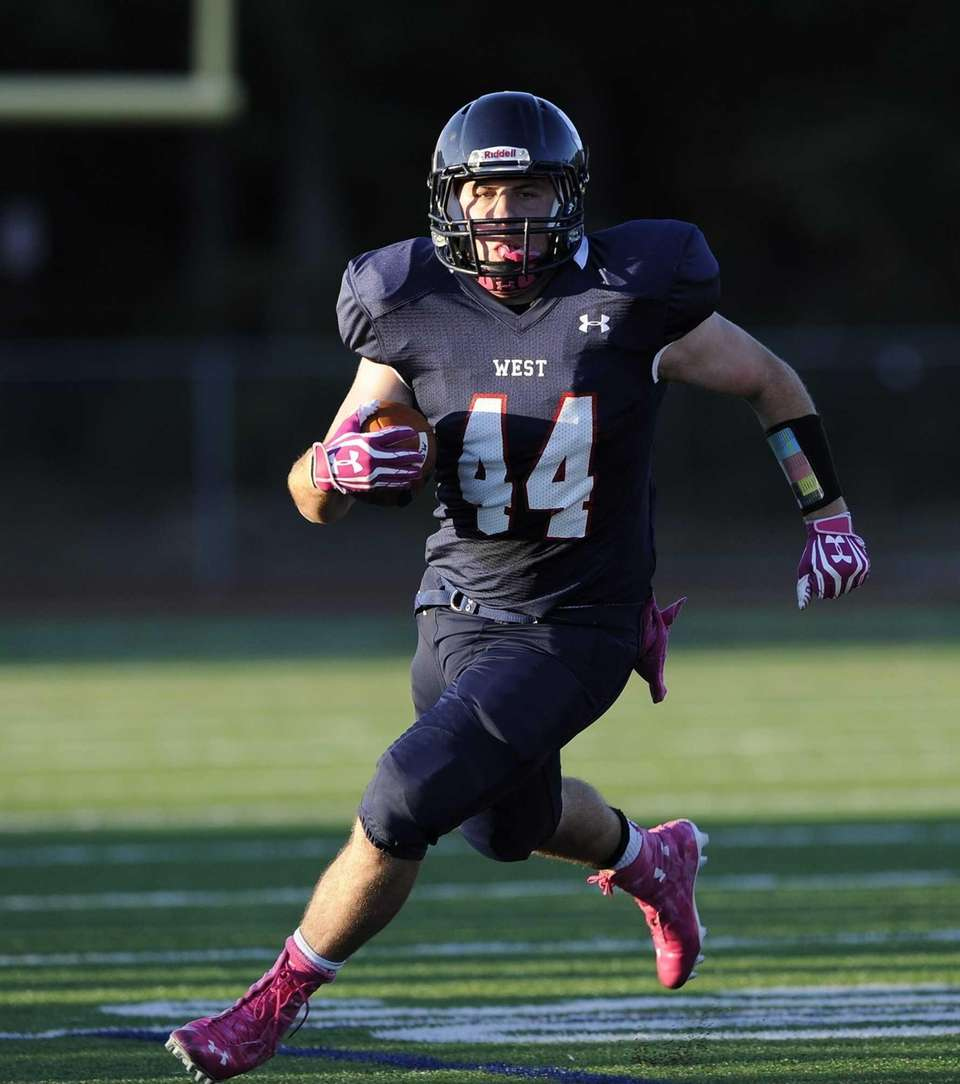 Smithtown West's Logan W. Greco gains yardage against