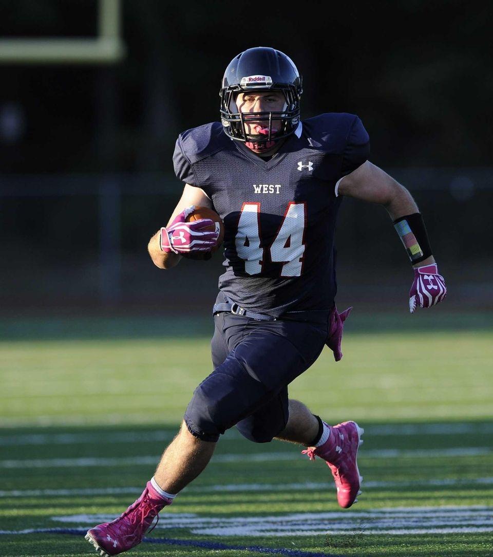 Smithtown West's Logan W. Greco gains yardage against