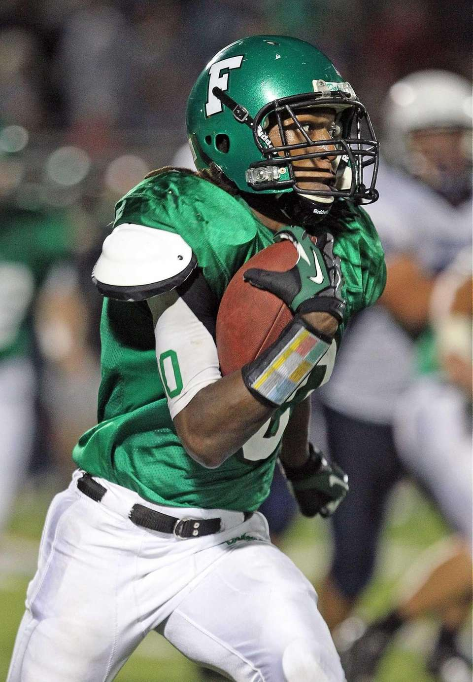 Farmingdale's Curtis Jenkins runs the ball against Oceanside.