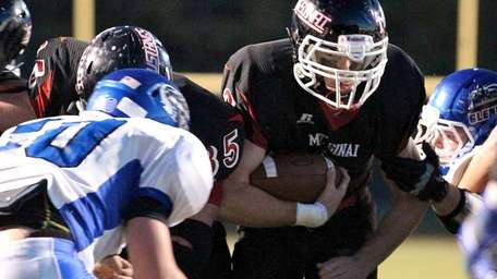 Mt. Sinai running back Zach Wolfe rumbles in