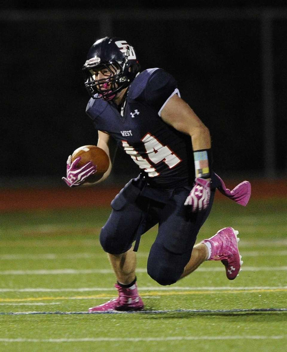 Smithtown West's Logan W. Greco runs the ball